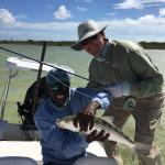 Tom's 6 pound bonefish with Harley the guide