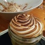 Mason jar banana cream pie and in the background, peanut butter mousse