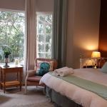 King Room , with Garden view, en-suite with bath & shower and has a dressind closet