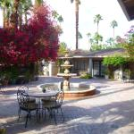 Fountain surrounded by bougainvillea and secluded hotel rooms