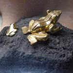 Gold frogs in display along tour.