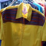 Shirt with mola is example of other crafts in gift shop.