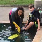 Doing the pool portion of the Jr. Open Water Diver certification with Senya