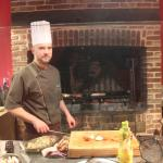 Chef cooking on open fire