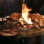Fish cooking near the entrance via glass screen