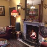 The splendid Victorian drawing room with a roaring open fire