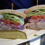 Turkey sandwich on rye with lettuce, tomato, onion