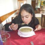 Sofia enjoying the fish soup