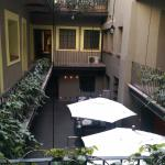 A view of the open air bar, courtyard and table area.