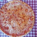 Pizza riquísima y enorme!