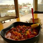Cape's seafood chowder with Camden Harbor in background