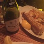 Seefoodplatter with kingklip, calamaris and scampi. And of course a nice bottle of chardonnay