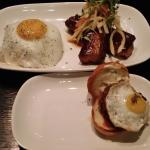 Adobo Pork Belly above, Wagyu slider below. Slider topped with a tiny quail egg.