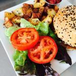 Fresh and Juicy Hamburger: Bread & Cie Bun / Caramelized Onions Local Tomatoes / Red Leaf Lettu