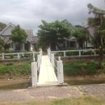 Bridge from beachfront villa to beach