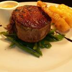Fillet steak, peppercorn cream and onion rings