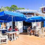 Enjoy outdoor dining with a great view of the Choctawhatchee Bay and Baytowne Marina