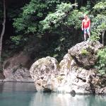 Jumping into the lagoon during our lunch break on the cave tubing adventure