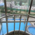 Beautiful open feeling with glass elevator shaft overlooking pool. View from room