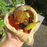 Falafel wrap with added chili oil and a pepper