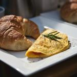 Omelettes with garden herbs and fresh baked croissants