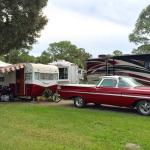 Old School Camper and tow vehicle in the park