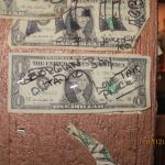 the dollar bill we signed and put up