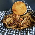Barbecued pulled pork with onion shavings and fries