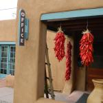 "Red chile ristra are emblems of ""welcome"" to our guests of Inn at Pueblo Bonito Santa Fe."