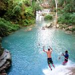 Jumping off waterfalls into the blue hole