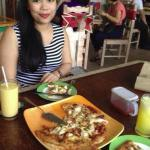 Seafood pizza and  fresh mango juice