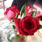Roses on each table.