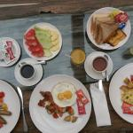 american breakfast with bread,egg,bacon.ham,fruit,tea,coffee and juice :)
