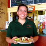 Jessica serving a taco ranchero