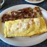 Shrimp and cheese omelet with onions and red potatoes on the side.