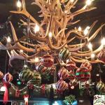 Beautiful antler chandalier at the entrance, adorned with ornaments