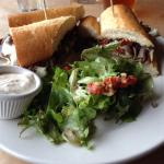 Roasted Shave Lamb sandwich with pea ridge casa salad