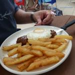 Steak, egg and hand cut potato chips