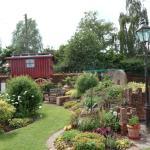 The beautiful front garden with gypsy caravan.