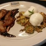 Poached Eggs on Zucchini & Yellow Squash Fritter and Breast of Duck on Smoked Concord Grape (loc