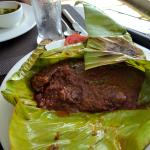 kerala pearl spot fish cooked in a banana leaf
