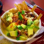 A cup of chicken tortilla soup