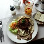 Typical Nicaraguan breakfast with steak and onions