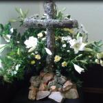 Small Cross and flowers at Palm Sunday service