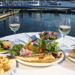 An assortment of our dishes by the beautiful water view.