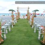 romantic marriage ceremony near the beach with bamboo decor.weddding took place at Acqualina Res