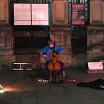 Cello Man playing across the street