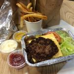 Cheeseburger (with more toppings hidden underneath) and fries. Delish!