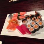 Various sashimi vs nigiri plus salmon roll