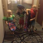 Hallway leading to pool! 3 happy kids.